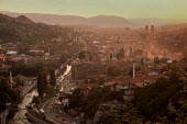 View of Sarajevo before the civil war from a nearby hill at dusk, showing the Miljacka river, the Ottoman Old Town in the middle distance and the 19th century Austro-Hungarian quarter behind. - Martin Mayer - 1990,1990s,Austro-Hungarian,balkan,balkans,bombard,Bosnian,bosnians,cities,city,cityscape,cityscapes,dusk,Eastern Europe,EBF,Economic,Economy,eu,european,europeans,EVENING,Herzegovina,hills,Miljaka,Ol