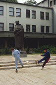 Boys play football outside the Communist Party offices in Sarajevo, after the break up of Yugoslavia. The Statue is of Durad Pucar, first President of the Peoples Republic of Bosnia and Herzegovina - Martin Mayer - 1990,1990s,balkan,balkans,ball,balls,before,Bosnia,bosnian,bosnians,BOY,Boys,break,break-up,child,children,cities,city,Civil War,Communist Party,communists,Durad,Eastern Europe,eu,european,europeans,f