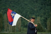 A supporter of the Bosnian Serb nationalist Serbian Democratic Party waves a Bosnian Serb flag while listening to a speech by their leader Radovan Karadzic at an election rally in Muslim majority town... - Martin Mayer - 1990,1990s,attention,attentive,balkan,balkans,Bosnian,bosnians,DEMOCRACY,Democratic Party,Eastern Europe,election,elections,eu,european,europeans,flag,flags,General Election,Herzegovina,intelligence,i