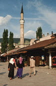 Young Muslim women walk through the Old Town in Sarajevo with The Gazi Husrev-bey Mosque, Sarajevo, Bosnia - Martin Mayer - 09-09-1990