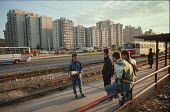 Young people wait for a tram near a high rise housing complex on the outskirts of Sarajevo, Bosnia - Martin Mayer - 09-09-1990