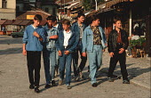 Teenage boys walking through the Old Town in Sarajevo, Bosnia, dressed in fashionable denim. Denim, preferably imported from the West, was a highly prized fashion item for young people in Eastern Euro... - Martin Mayer - 09-09-1990