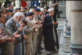 Men praying in the Gazi Husrev-beg Mosque, Sarajevo, Bosnia - Martin Mayer - 09-09-1990