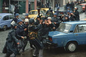 Riot police attack a single transport worker during demonstrations against the Muslim controlled council in Gorazde, Eastern Bosnia. - Martin Mayer - 10-09-1990
