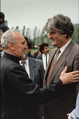 Serbian nationalist leader Radovan Karadzic is greeted by an Orthodox priest at an election rally in Gorazde, Eastern Bosnia. - Martin Mayer - 10-09-1990