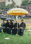 Orthodox priests sitting in pride of place at an election rally by the Bosnian Serb nationalist Serbian Democratic Party addressed by its leader Radovan Kardzic in Gorazde, Eastern Bosnia - Martin Mayer - 10-09-1990