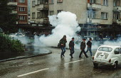 Police clear the streets with tear gas during a demonstration by transport workers in Gorazde, Eastern Bosnia - Martin Mayer - 10-09-1990