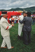 Radovan Karadzic, leader of the Bosnian Serb nationalist party - The Serbian Democratic Party - is greeted by a leading supporter on his arrival at an election rally in Gorazde, Eastern Bosnia during... - Martin Mayer - 12-09-1990