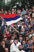 Supporters of the Bosnian Serb nationalist Serbian Democratic Party cheer a speech by their leader Radovan Karadzic at an election rally in Muslim majority town of Gorazde in eastern Bosnia. - Martin Mayer - 12-09-1990