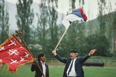 Supporters of the Bosnian Serb nationalist party Serbian Democratic Party waving Bosnian Serb flags at an election rally in the Muslim majority town of Gorazde in Eastern Bosnia - Martin Mayer - 12-09-1990