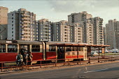 Tram and high rise housing in suburbs of Sarajevo, Bosnia. Also visible advert on side of tram for the East German film Orwo (now discontinued) - Martin Mayer - 12-09-1990