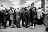 Queueing for the dole in a Derry unemployment office, Northern Ireland - Martin Mayer - , Irish,1970s,1971,benefit,BENEFITS,catholic,catholics,Derry,Dole,employee,employees,Employment,Ireland,IRISH,job,jobless,jobs,jobseeker,jobseekers,lbr,line,Londonderry,Marginalised,nationalist,nation