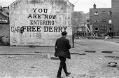 You are now entering free Derry. Entrance to the no-go area of the Bogside, Derry, Northern Ireland, 1971 where British troops were kept out by armed IRA men after the introduction of internment. - Martin Mayer - 1970s,1971,area,armed,Armed Forces,army,British Army,catholic,catholics,cities,city,communities,community,conflict,conflicts,Derry,Entrance,Free,internment,IRA,Ireland,Irish,Londonderry,military,mural