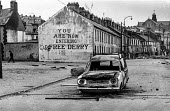 You are now entering free Derry. Entrance to the no-go Bogside, Derry, Northern Ireland, 1971 where British troops were kept out by armed IRA men after the introduction of internment - Martin Mayer - 1970s,1971,area,armed,Armed Forces,army,Bogside,British,British Army,catholic,catholics,cities,city,communities,community,conflict,conflicts,Derry,Entrance,Free,IRA,Ireland,Irish,Londonderry,military,
