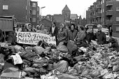 Council workers strike. Tenants protest at the rubbish mounting up outside their flats. - Martin Mayer - 03-11-1970