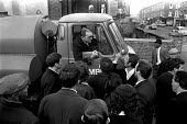 Council workers strike 1970. Pickets in Lambeth, South London, trying to persuade a dustcart driver from entering a depot - Martin Mayer - 09-10-1970
