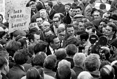 Press and workers besiege union leaders at the end of a mass meeting at Ford workers during the 1971 strike, Dagenham. Moss Evans TGWU and Ron Todd (L) in the centre, both of them became leaders of th... - Martin Mayer - 14-03-1971