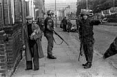 Old man as British soldiers patrol the Protestant Crumlin Road area Belfast 1971 shortly after the announcement of internment without trial in Northern Ireland - Martin Mayer - 14-08-1971
