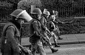 British army patrol in the Protestant Crumlin Road area, Belfast 1971 shortly after the announcement of internment without trial in Northern Ireland, after an incident in which another soldier was sho... - Martin Mayer - 14-08-1971
