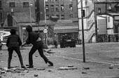 Stone throwing youths confronting British army, The Bogside, Derry, Northern Ireland, 1971 shortly after the introduction of internment without trial - Martin Mayer - , Irish,1970s,1971,area,armed,Armed Forces,armored,armoured,armoured car,arms,army,Bogside,British,British Army,carrier,catholic,catholics,cities,city,communities,community,conflict,conflicts,confront