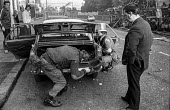 British soldiers searching a car in the Protestant Crumlin Road area of Belfast, during an incident in which a soldier was shot, soon after the introduction of internment without trial - Martin Mayer - 17-08-1971