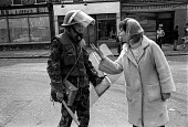 A Catholic woman confronts a British soldier in the Catholic enclave of Short Strand in the mainly Protestant East Belfast just after the imposition of internment without trial - Martin Mayer - 1970s,1971,activist,activists,anger,angry,argue,arguing,argument,armed,Armed Forces,arms,army,baton,batons,Belfast,British,British Army,CAMPAIGN,campaigner,campaigners,CAMPAIGNING,CAMPAIGNS,Catholic,c