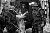 A Catholic woman confronts a British soldier in the Catholic enclave of Short Strand in the mainly Protestant East Belfast just after the imposition of internment without trial - Martin Mayer - 10-08-1971