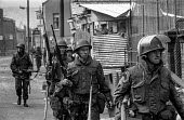 Nervous looking British troops patrolling in the Short Strand Catholic enclave in the mainly Protestant East Belfast just after the imposition of internment without trial - Martin Mayer - 10-08-1971