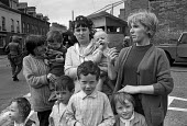 Catholic women (L-R) Betty Dorrian, Margaret Watters and Margaret Garland with their children protesting at a British army post in the Catholic enclave of Short Strand in East Belfast on day 2 of inte... - Martin Mayer - 10-08-1971