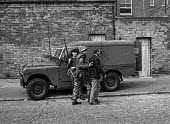 Catholic man Mr James Quinn is arrested by British soldiers in the Catholic Short Strand enclave of East Belfast after he complained about the UVF wrecking houses vacated by Protestants so that Cathol... - Martin Mayer - 10-08-1971