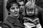 Mrs Quinn with her daughter Maria after witnessing the arrest of her husband James Quinn by British army, 1971 in the Catholic area of Short Strand, East Belfast on day 2 of internment without trial - Martin Mayer - 10-08-1971