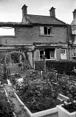House vacated by a Protestant family after trouble with the predominant Catholic community, Ardoyne estate, Belfast, 1971 after the imposition of internment without trial, is wrecked and burnt to prev... - Martin Mayer - 10-08-1971
