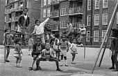 Children on a Brixton council estate, summer 1970 Ferndale Court, blocks of flats, 1970 - Martin Mayer - 1970s,areas,BAME,BAMEs,black,BME,bmes,boy,boys,Brixton,child,CHILDHOOD,children,cities,city,climbing,communities,community,council,council estate,council services,council estate,council services,Court
