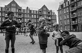 Children playing on a Brixton council estate, summer 1970 Ferndale Court, blocks of flats, 1970 - Martin Mayer - 1970s,areas,BAME,BAMEs,black,BME,bmes,boy,boys,Brixton,child,CHILDHOOD,children,cities,city,council,council estate,council services,council estate,council services,Court,cultural,Diaspora,diversity,et