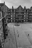 A 1920s council estate in Brixton, South London. Ferndale Court, blocks of flats, 1970 - Martin Mayer - 1920s,1970s,areas,balconies,BAME,BAMEs,Black,BME,bmes,boy,boys,Brixton,child,CHILDHOOD,children,cities,city,council,council estate,council services,council estate,council services,Court,diversity,ethn