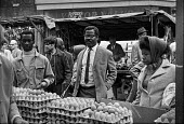 Brixton market, South London, summer 1970 - Martin Mayer - 1970s,BAME,BAMEs,black,BME,bmes,bought,Brixton,buy,buyer,buyers,buying,cities,city,commodities,commodity,consumer,consumers,cost of living,cultural,customer,customers,Diaspora,diversity,EARNINGS,EBF,E