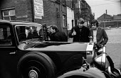 Striking gas workers picket a Rolls Royce outside the Stockport gasworks, Greater Manchester - Martin Mayer - ,1970s,1972,AFFLUENCE,AFFLUENT,AUTO,AUTOMOBILE,AUTOMOBILES,AUTOMOTIVE,Bourgeoisie,car,cars,DISPUTE,DISPUTES,elite,elitism,EQUALITY,Gas Board,Gas workers,gasworks,high,high income,income,INCOMES,INDUST