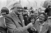 A supporter trying to shake Jim Callaghan's hand as he leaves church before the 1978 Labour Party conference in Blackpool. Behind him is his wife Audrey (L) - Martin Mayer - 01-10-1978