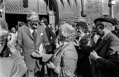 A supporter trying to shake Jim Callaghan's hand as he leaves church before the 1978 Labour Party conference in Blackpool. Behind him is his wife Audrey (in hat). - Martin Mayer - 01-10-1978