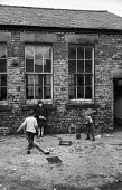 Children play outside abandoned factory in slum clearance area, Everton, Liverpool - Martin Mayer - 1970s,1972,abandoned,boy,boys,building,BUILDINGS,child,CHILDHOOD,children,cities,city,clearance,CLEARENCE,clearing,council,Council Housing,Council Housing,derelict,DERELICTION,developer,developers,dev