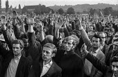 A meeting of Morris car workers voting for a strike, Cowley, Oxford against Measured Day Work. At this time there was on average one industrial dispute a day in the British Leyland Cowley car factory. - Martin Mayer - 1970,1970s,AEEU,against,automotive,BL,BLMC,British Leyland,car industry,car workers,carindustry carindustry,Cowley,democracy,dispute,disputes,Hands up,INDUSTRIAL DISPUTE,mass meeting,Mass Meeting mass