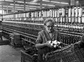A woman at work in a cotton mill in Ashton-under-Lyne, Greater Manchester, Lancashire - Martin Mayer - 10-08-1970
