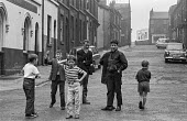 Children playing in the street in Ashton-under-Lyne, Greater Manchester, Lancashire just before the traditional Wakes Week holiday - Martin Mayer - 10-08-1970