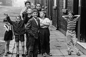 Children playing in the street in the cotton town of Ashton-under-Lyne, Greater Manchester before the traditional Wakes Week holiday - Martin Mayer - 10-08-1970