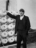 Cotton mill worker, Ashton-under-Lyne, Greater Manchester, Lancashire - Martin Mayer - 1970,1970s,apparel,Ashton-under,capitalism,cities,City,Cotton,EBF,Economic,Economy,employee,employees,Employment,FACTORIES,factory,GARMENT,Greater,Industries,INDUSTRY,job,jobs,KNITWARE,KNITWEAR,Lancas