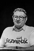 Eric Heffer MP wearing a Solidarnosc T-shirt in support of the Polish trade union, 1981 Labour Party conference - Martin Mayer - trade union,1980s,1981,conference,conferences,Eric,Heffer,Labour,Labour Party,left,left wing,Leftwing,male,man,member,member members,members,men,MP,MPs,Party,people,person,persons,POL,Polish,political