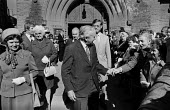 Mary Wilson, Harold Wilson shaking hands with a suporter after Sunday church service, 1975 Labour Party conference, Blackpool. - Martin Mayer - 1970s,1975,Blackpool,church,churches,conference,conferences,FEMALE,hands,Harold,Labour Party,male,man,Mary,men,MP,MPs,Party,people,person,persons,POL,political,politician,politicians,Politics,service,