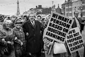 Vic Feather TUC and pensioners protesting for higher payments TUC conference, Blackpool 1973 - Martin Mayer - 1970s,1973,activist,activists,adult,adults,age,ageing population,Blackpool,CAMPAIGN,campaigner,campaigners,CAMPAIGNING,CAMPAIGNS,conference,conferences,DEMONSTRATING,demonstration,DEMONSTRATIONS,elder