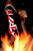 Union Jack buring on a republican bonfire, The Bogside, Derry, Northern Ireland 1989 - Mark Pinder - 1980s,1989,activist,activists,bonfire,bonfires,burn,burning,BURNS,CAMPAIGN,campaigner,campaigners,CAMPAIGNING,CAMPAIGNS,catholic,catholics,conflicts,DEMONSTRATING,DEMONSTRATION,DEMONSTRATIONS,Derry,fi