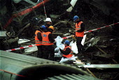 Police forensic and accident investigators sift through the wreckage of the passenger train Selby rail crash, Great Heck near Selby, Yorkshire, UK. - Mark Pinder - 01-03-2001